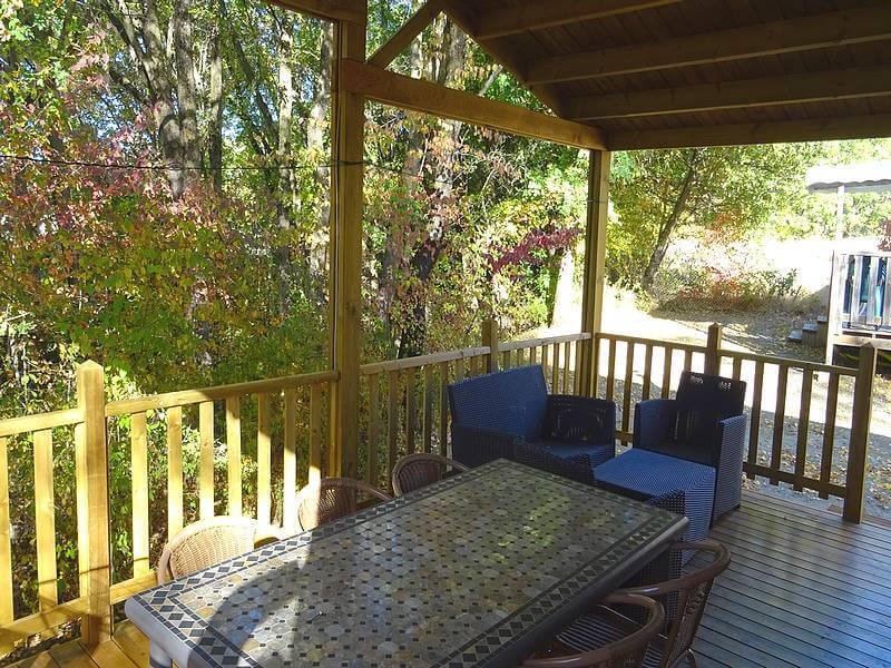 Comfortable chalet terrace furnished with table and garden furniture