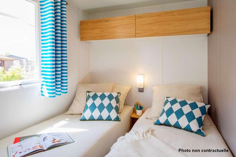 2 chambres enfants dans le mobil home premium au camping du lac à Curbans